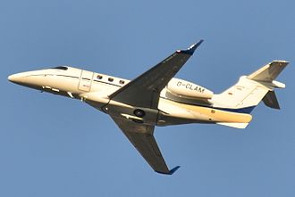Embraer Phenom 300 - From below, showing its swept wing