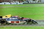 Damon Hill - Williams FW15C dives inside Thierry Boutsen - Jordan 193 at the 1993 British Grand Prix (33686736145).jpg