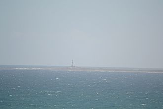 Dassen Island - Image: Dassen Island and lighthouse, 9km off the coast of Yzerfontein. Lighthouse is 28m, circular iron tower with white and red bands. 1893. 02