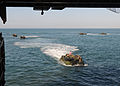 Defense.gov News Photo 100830-N-8069G-296 - U.S. Marine Corps amphibious assault vehicles prepare to enter the well deck of the amphibious dock landing ship USS Carter Hall LSD 50 while the.jpg