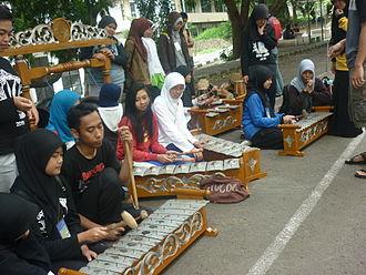Gamelan degung - Sundanese students playing gamelan degung on the street.