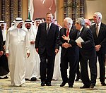 Dick Cheney and George H. W. Bush walk with newly crowned King Abdullah.jpg