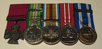 Battle of Khaz Oruzgan - Trooper Mark Donaldson's medals on display at the Australian War Memorial in Canberra. From left to right they are the Victoria Cross for Australia, Australian Active Service Medal with ICAT clasp, Afghanistan Medal, Australian Defence Medal and NATO Medal for the Non-Article 5 ISAF Operation in Afghanistan.