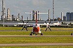 Dornier 328 at BNE (5777687164).jpg