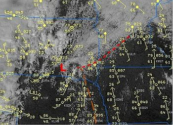 Satellite view of the convection around a dry line. The Temperature in Fahrenheit at around 86 over the whole clear area but the dew point drop from the 60's, East of the brown line, to the 50', to its West.