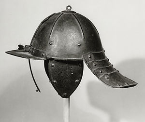 Lobster-tailed pot helmet - Lobster-tailed pot helmet. This example has a single sliding nasal bar and fixed peak to protect the face, Dutch mid-17th century