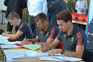 Germany at the 2016 Summer Olympics - Martin Wolfram, Sascha Klein and Patrick Hausding (from left) at the Clothing of the German Olympic team.