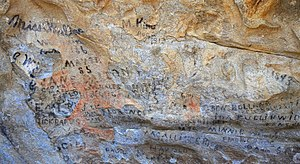 City of Rocks National Reserve - Emigrant inscriptions in axle grease on Camp Rock, City of Rocks National Reserve, Idaho.