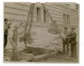 Exterior marble work - men flanking a piece of marble being hoisted (NYPL b11524053-489492).tiff