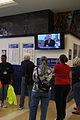 FEMA - 37728 - Volunteers watch a news broadcast in Louisiana while helping residents evacuate.jpg