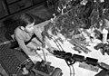 Fiú játszik egy karácsonyfánál 1942-ben Budapesten. Fortepan 72013.jpg