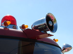 Siren (alarm) - Warning siren and emergency lights mounted on a fire truck