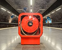 Fire hose cabinets in Solna strand Metro station August 2019 01.jpg