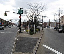 A traffic island where Flushing and Grand Avenues split