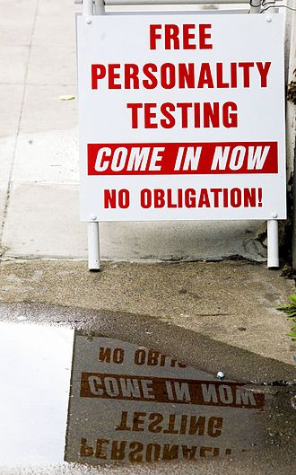 Oxford Capacity Analysis - Sign advertising Scientology personality tests. San Francisco, April 2006.