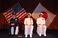 From left, U.S. Air Force Lt. Gen. Salvatore A. Angelella, commander of U.S. Forces Japan; U.S. Navy Rear Adm. Dan Cloyd; and Rear Adm. Terry B. Kraft listen to a speaker during a change of command ceremony 130823-N-DS193-042.jpg