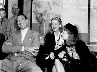 Una Merkel - Una Merkel (right) with Phyllis Brooks and Gary Cooper at a Brisbane press conference on their way to entertain the troops (1943)