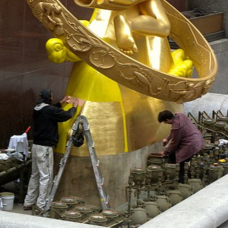 Gilding - Regilding the statue Prometheus