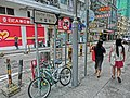 HK 天后 Tin Hau 木星街 Jupiter Street name sign June-2014 King's Road 東亞銀行 BEA shop bike visitors.JPG