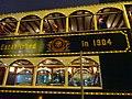 HK Wan Chai night Johnston Road Hongkong Tramways number 28 green Dec-2015 established in 1904.JPG