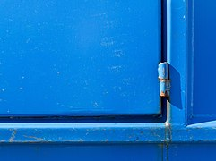Hinge on blue dumpster.jpg