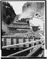 Historic view (May, 1933) of roadbed extension under construction. - Golden Gate Viaduct, Lake, Teton County, WY HAER WYO,20-YELNAP,2-3.tif