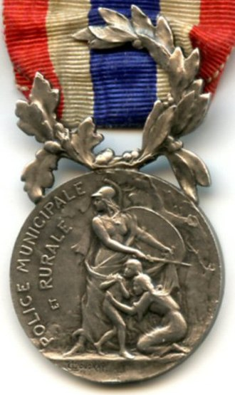 Honour medal of the National Police - Early design of the obverse with original designation for the municipal and rural police