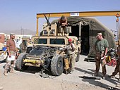 Humvee maintenance with engine exposed by Czech Army in Afghanistan