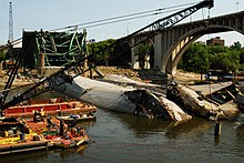 Navy recovery operation on the bank of the Mississippi with the twisted wreckage