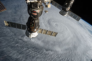 Soyuz TMA-17M - Soyuz TMA-17M flying above Typhoon Soudelor while docked to the ISS