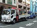 ISUZU FORWARD, White truck with red crane & bule ELF.jpg