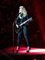 Madonna playing a guitar