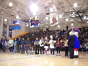 Independence High School (San Jose, California) - Sammy the Sixer, the Independence High School mascot, at an awards assembly in the school gymnasium, with onlooking student leaders and students.