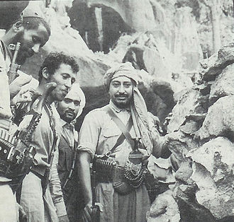North Yemen Civil War - Muhammad al-Badr outside his cave on Jabal Sheda. With him is his cousin, Prince Hassan bin Hussein.