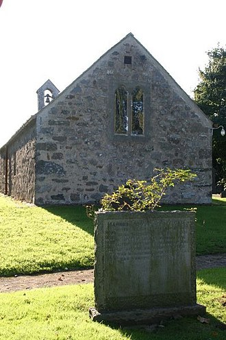 St Mary's Church, Llanfair-yn-y-Cwmwd - The gravestone of Maurice Wilks at the east end of the church