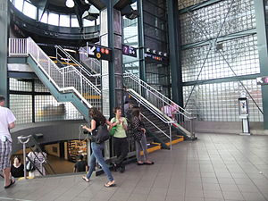 Jackson Heights–Roosevelt Avenue/74th Street (New York City Subway) - Staircases to the platforms from fare control. The IND Queens Boulevard Line staircases are to the left, while the IRT Flushing Line staircases are to the right.