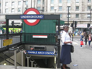 Jehovah's Witnesses publications - A Jehovah's Witness distributing literature at Marble Arch tube station in London
