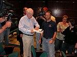 John McCain signs an autograph (478824882).jpg