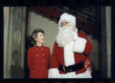John Riggins as Santa and Nancy Reagan unveil Christmas decorations at White House 1984, photo 15