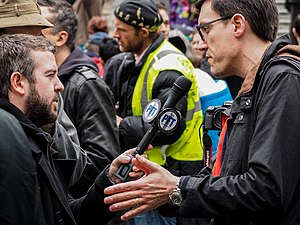 British Columbia Civil Liberties Association - BC Civil Liberties Association Executive Director Joshua Paterson (right) interviewed on the steps of the Vancouver Art Gallery during the Bill C-51 protest on March 14, 2015.