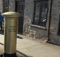Josie Pearson's gold post box in Hay-on-Wye, Powys (1).jpg
