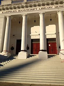 Facade of imposing building with Greek columns.