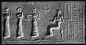 Ur-Nammu (seated) bestows governorship on Ḫašḫamer, ensi of Iškun-Sin (cylinder seal impression, ca. 2100 BCE).