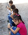 Kids Eat Ice Cream on Sidewalk - Puerto Vallarta - Jalisco - Mexico (11347852413).jpg