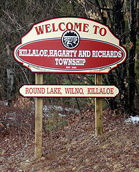 Welcome sign on Round Lake Road