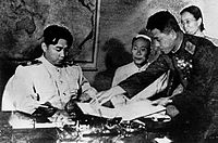 Kim Il-sung signed for Korean Armistice Agreement.jpg