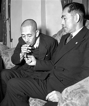 Nobusuke Kishi - Nobusuke Kishi (1896–1987, left) relaxes at the house of his brother, the then Chief Cabinet Secretary Eisaku Satō (1901–75), shortly after he was released from Sugamo Prison on 24 December 1948.
