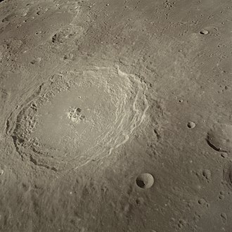 """Langrenus (crater) - This view is from Apollo 8, the first manned mission to the moon.  During the mission, astronaut James Lovell described Langrenus as """"quite a huge crater; it's got a central cone to it. The walls of the crater are terraced, about six or seven terraces on the way down."""""""