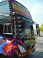 Large bus in Thailand with many mirrors.JPG