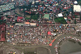 Housing inequality - Aerial view of a slum in a suburb of Manila
